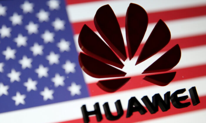 FILE PHOTO: A 3D printed Huawei logo is placed on glass above displayed US flag in this illustration